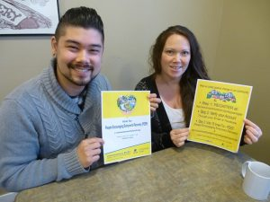 Evan Dear, mental health facilitator, and Chantelle Burga, New View clubhouse manager, with posters encouraging people to vote in the Aviva Community Fund contest for the New View Society's People Encouraging Everyone's Recovery progra Photograph By Diane Strandberg